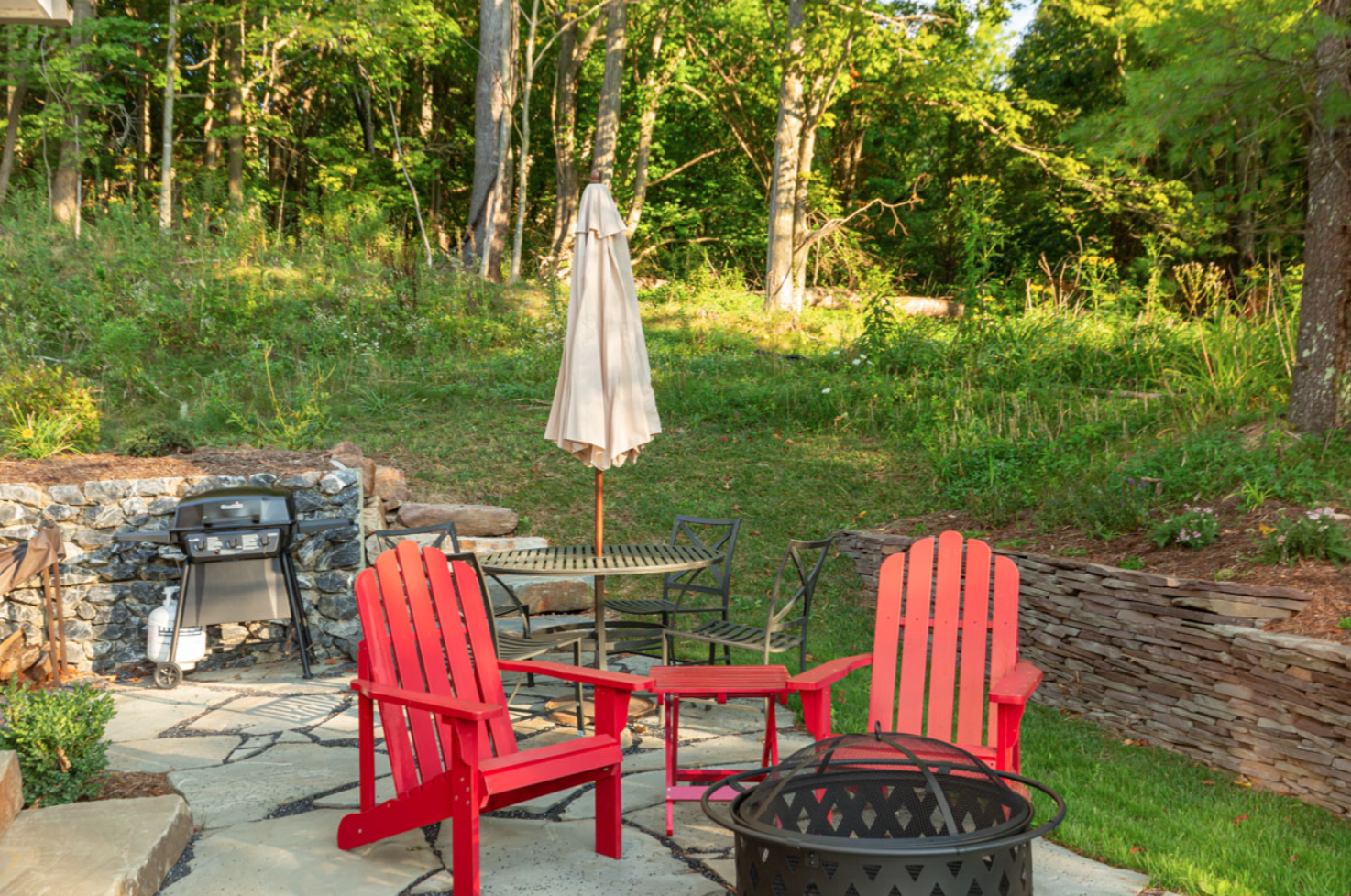 red lawn chairs on back patio